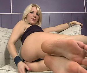 Ashley Fires play her feet after taking off her boots