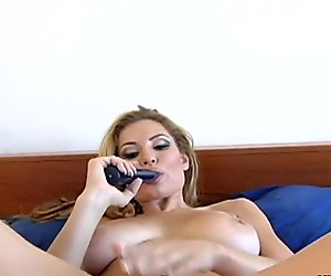 Blonde babe with large knockers masturbating with a thick di