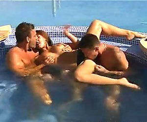 Sexy babe fucked and jizzed by two by the pool