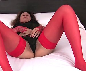 Hairy mature in red stockings