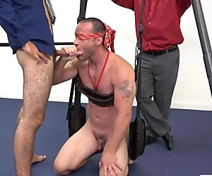 Blindfolded and fucked in a threesome by his coworkers