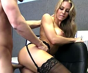 Jaw-dropping beauty fucks doggy style right in the office