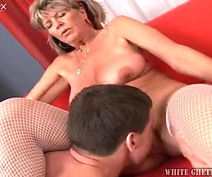Nasty granny with pigtails fucks horny young lad