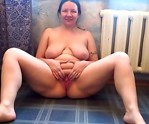 mature chick with big tits, pissing fountain!