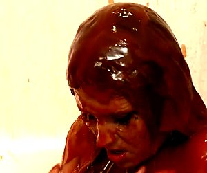 Whorish all naked horny girlie gets chained and takes a ketchup bath