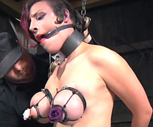 Chained bdsm sub caned and whipped by her dom