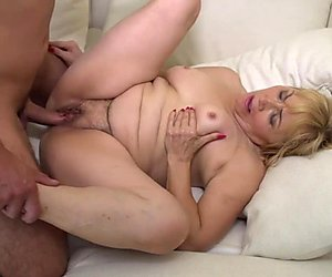 Hairy GILF takes a young cock