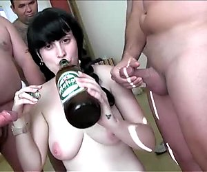 Ugly brunette whore with pigtails and big tits takes part in hard gangbang fuck