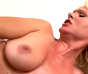 Curvy blonde masturbates before stud comes to bang her