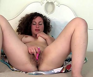 Curly Haired Lara Vibrating Her Pussy